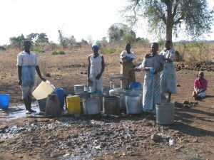 Women of Mbuzi, Africa line up for daily water needs