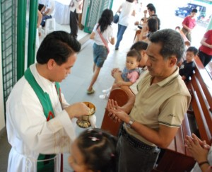 Priest serving Mass in Missions