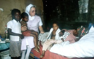 Sister Ingrid visits with Naomi & her family
