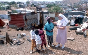 Sister Ingrid visits the poor in Katutura, Africa.