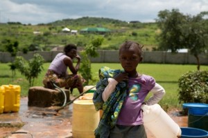 Child at well in Zambia