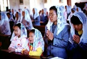 Chinese Family in Zhou Zhi during Mass
