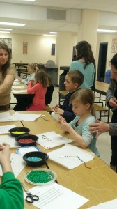 Students from St. Robert's PREP in Warrington making rosaries given to Missionaries.
